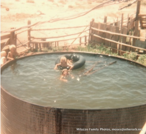 Me and my brother Cedar swimming in the Big Tank. We lived in the tank all summer - it was the only way to stay cool. We also used it to water our cornfield.